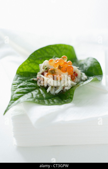 Caviar and fish in leaf - Stock Image