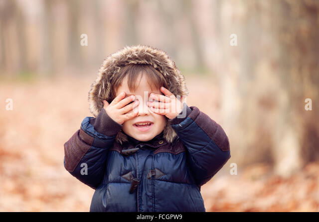 Funny boy hooded jacket see no evil - Stock Image