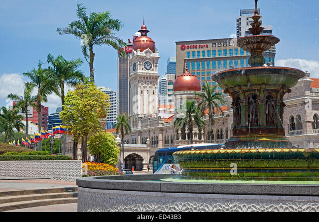 Merdeka Square showing fountain and the clock tower of the Sultan Abdul Samad Building in the city Kuala Lumpur, - Stock Image