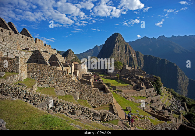 Machu Picchu with Huaynu Picchu behind in the Sacred Valley of Peru at sunrise. - Stock Image