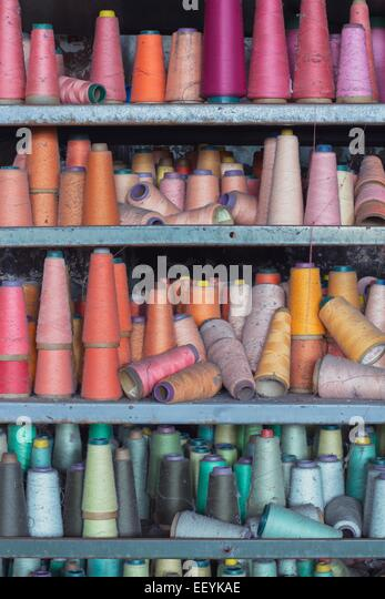 Spools of colorful thread left behind at an abandoned factory. - Stock-Bilder
