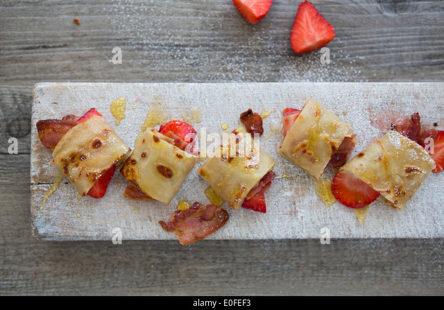 Bacon, Strawberry & Maple Syrup Savoury Pancakes - Stock Image