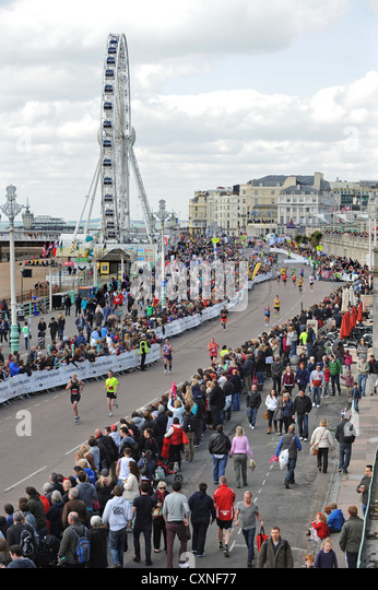A packed seafront as runners head for the finish line during the Brighton Marathon 2012 - Stock Image