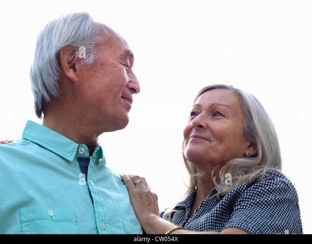 Older couple smiling together - Stock Image