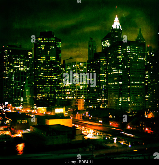New York City at night with highrise buildings - Stock Image