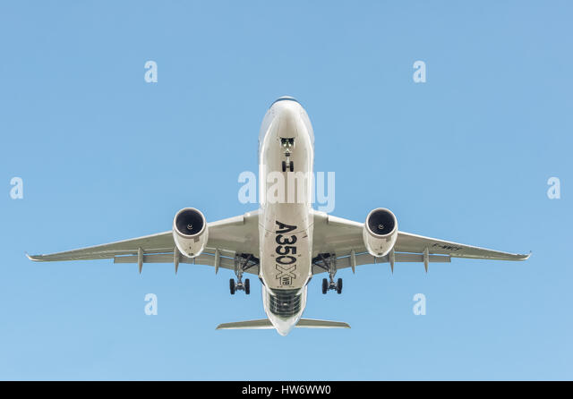 Airbus A350 XWB, in a clear blue sky, landing at an international aviation trade event in Farnborough, UK - Stock Image