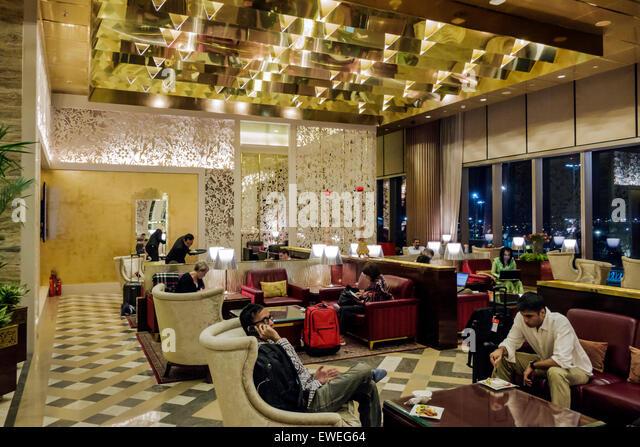 Mumbai India Indian Asian Chhatrapati Shivaji International Airport terminal concourse gate area inside interior - Stock Image