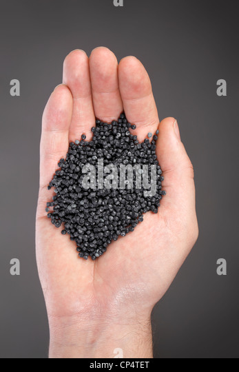Granular recycled plastic made of car bumpers etc. - Stock Image