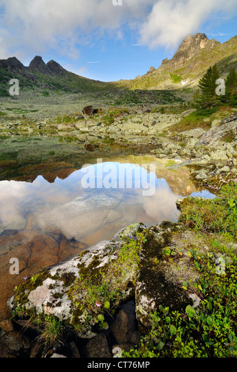 view at hudijnikov pass from nizhneye buibinskoe lake - Stock Image