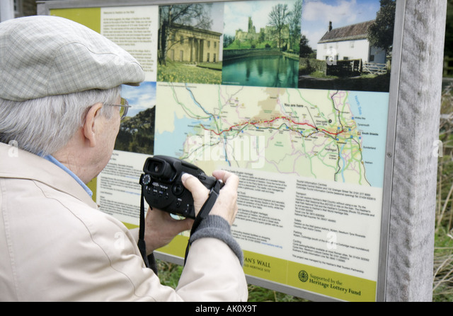 UK, England, Heddon on the Wall, Hadrians Wall, man, camera, map, - Stock Image