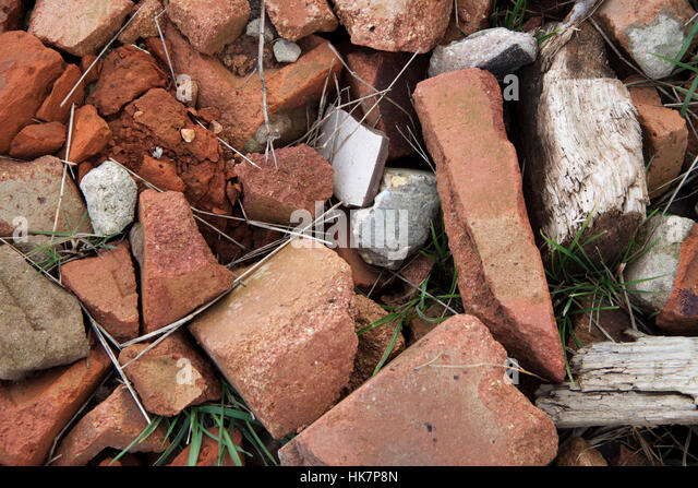 Broken red bricks plus some weathered wood make a background texture - Stock Image