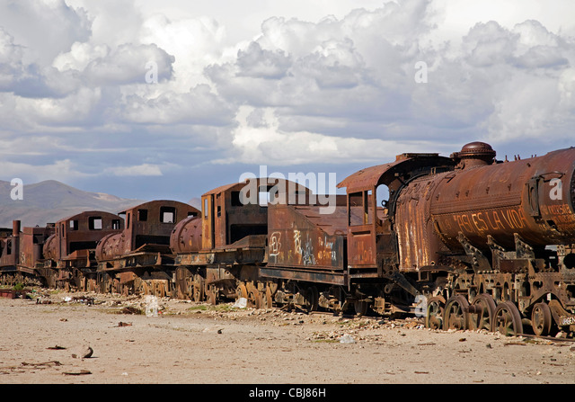 Rusty locomotive engines at cemetery of trains near Uyuni, Altiplano, Bolivia - Stock Image