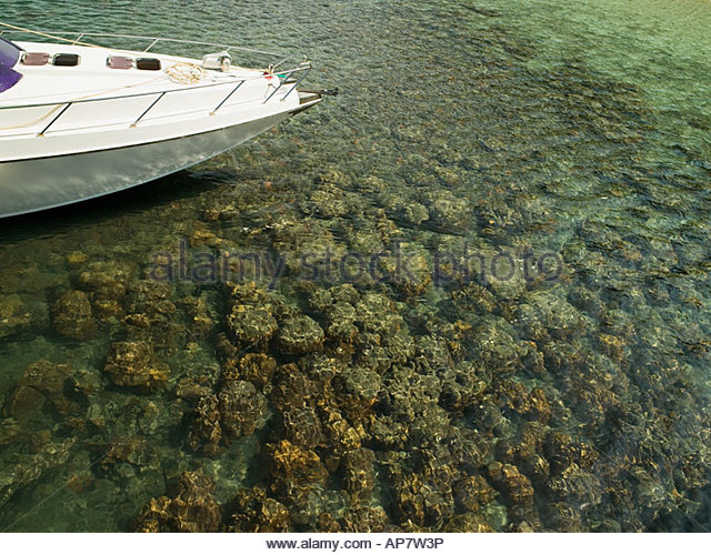 Boat and clear sea - Stock Image