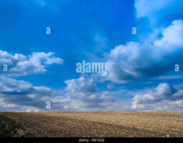 Farmland with rain clouds - France. - Stock Image