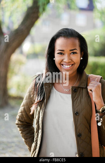 Sweden, Sodermanland, Strangnas, Portrait of teenage girl (16-17) in park - Stock Image