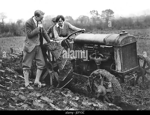 EVE BALFOUR (1898-1990) British  organic farming pioneer on a Ferguson tractor about 1925 - Stock-Bilder