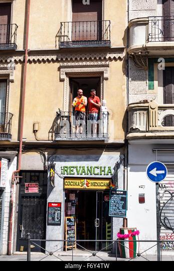 Spain Europe Spanish Hispanic Madrid Centro Chueca Calle Hortaleza residential apartment above business - Stock Image