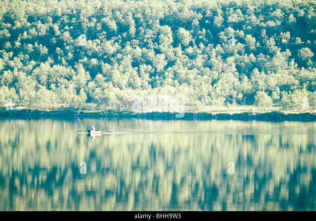 A rowboat on a lake in the mountains, Sweden. - Stock Image