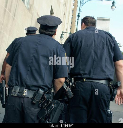 Three New York City Police Officers Walking Viewed From Behind Taken on September 11 2008 at Ground Zero World Trade - Stock Image