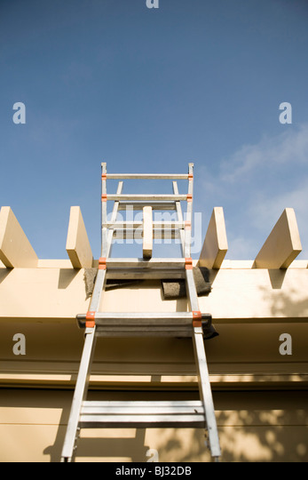 Workmans ladder to roof - Stock Image