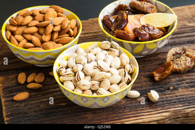 Mix of dried fruits, candied fruits with pistachio and almond nuts - Stock Image