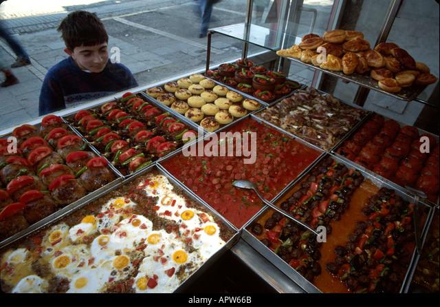 Turkey Europe Asia Istanbul Beyoglu Quarter Pehlivan Lokantasi Cafeteria food window display Muslim boy - Stock Image