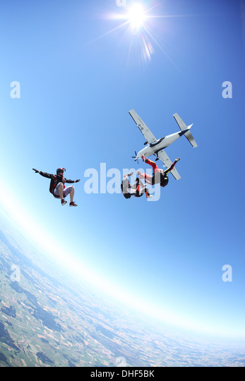 Skydivers free falling above Leutkirch, Bavaria, Germany - Stock-Bilder