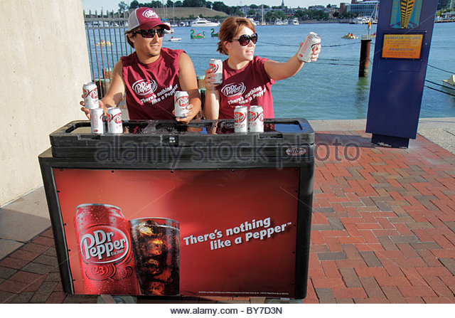 Maryland Baltimore Inner Harbor waterfront Harborplace festival marketplace free sample Dr. Pepper product marketing - Stock Image
