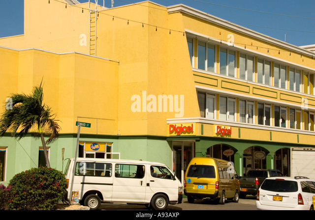Grand Cayman George Town business district offices stores bright yellow and green - Stock Image