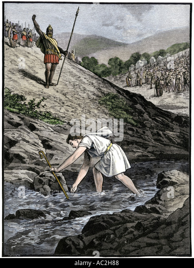 David picking a stone with which to fight giant Goliath of the Philistines - Stock Image
