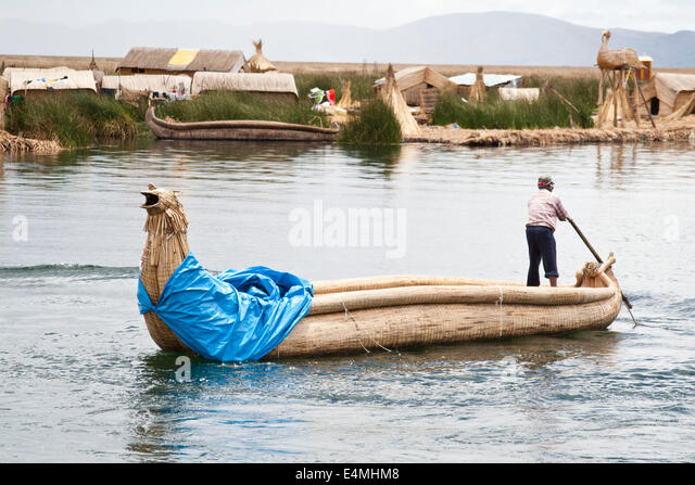 Lake Titicaca, shared by Peru and Bolivia, is the cradle of ancient ethnic and indigenous groups that inhabit the - Stock-Bilder