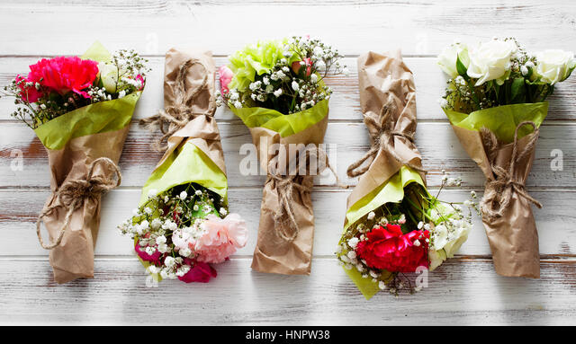 Mini flower bouquet with roses and carnation - Stock Image