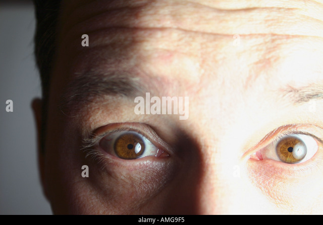 Close up and personal hypnotic brown eyes - Stock Image