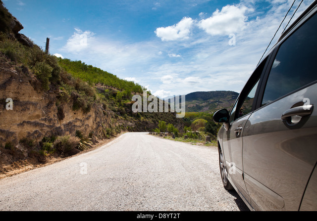 Travel by car - curvy road and beautiful landscape ahead - Stock-Bilder