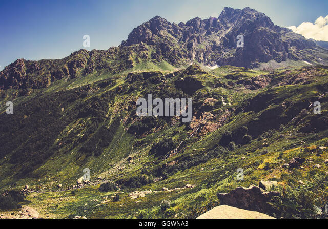 High Rocky Mountains and blue sky Landscape in Abkhazia Summer Travel serene scenic view - Stock Image