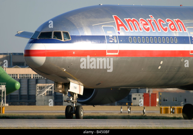 Close-up of Boeing 777 American Airlines taxiing for departure at London Heathrow Airport UK - Stock Image