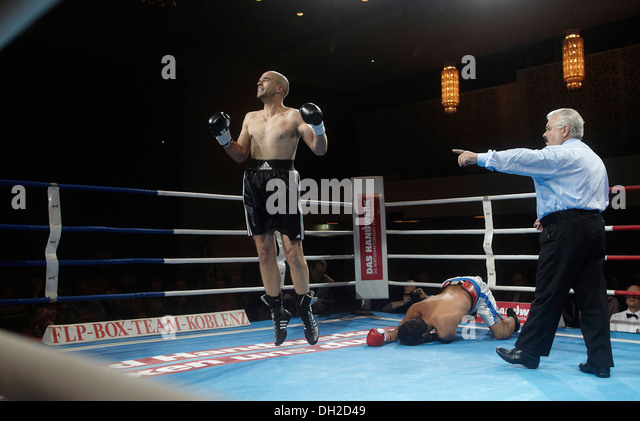 Professional boxing match, Michael Stromberg celebrating after a knock-out win over Mavran Schade, Rhein-Mosel-Halle, - Stock Image