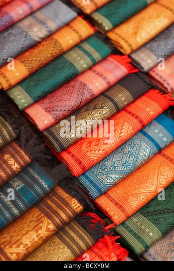 silk textiles for sale in the Night Market, Luang Prabang, Laos - Stock Image