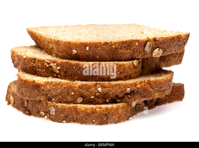 Wholemeal granary bread slices on white cutout - Stock Image