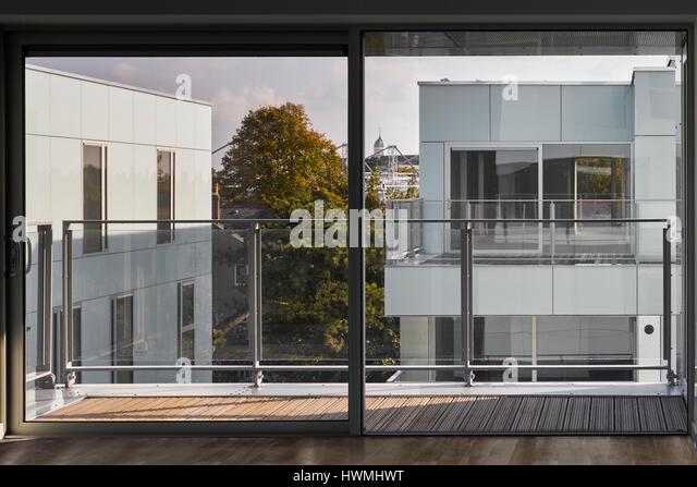 Interior view of third floor apartment showing glass sliding doors to exterior. Dunluce Apartments, Ballsbridge, - Stock-Bilder