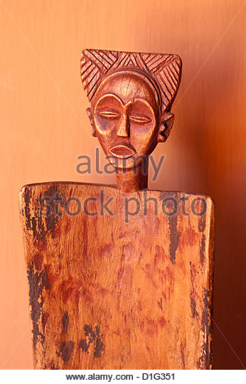 Local artwork depicting female faces, Okahirongo Lodge, Namibia, Africa - Stock Image