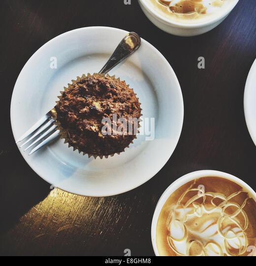 View of Honey Vanilla Lattes and muffin - Stock-Bilder
