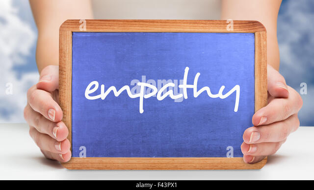 Empathy against bright blue sky with clouds - Stock Image
