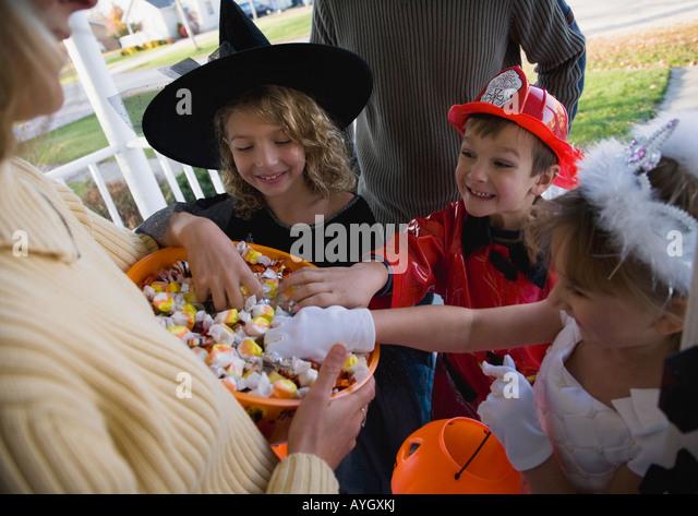 children-in-halloween-costumes-reaching-