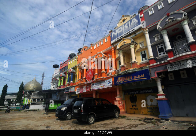 Shops and mosque along main street in Sorong, Papua province, Indonesia. No PR - Stock Image