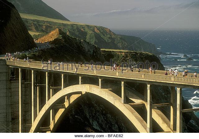 Big Sur Marathon runners on Bixby bridge, Big Sur, California - Stock Image
