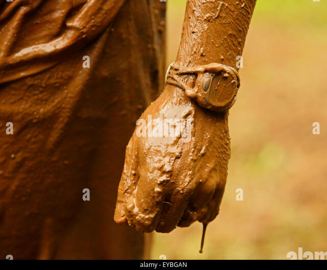 Closeup of mud-soaked watch, hand and arm at the Mud Run for Heart July 25, 2015, Waterford, New Brunswick, Canada. - Stock-Bilder
