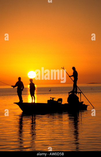 Sunset fishing Florida Bahamas bonefishing silhouette - Stock Image