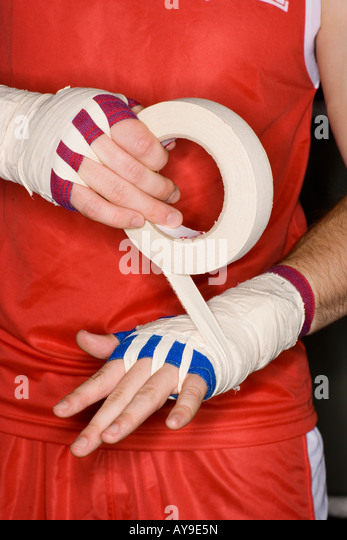 Preparing hands with boxing tape - Stock Image