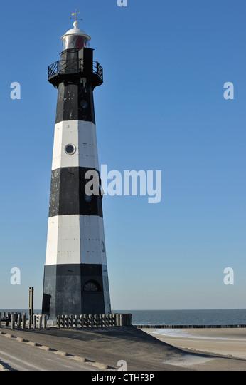 Nieuwe Sluis, oldest cast iron lighthouse in the Netherlands marks the entrance to the Westerschelde at Breskens, - Stock-Bilder